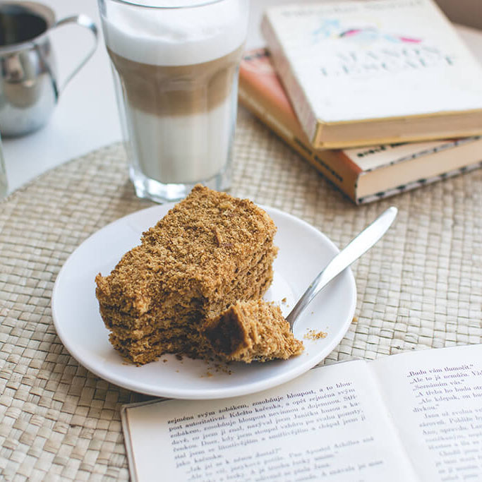 foodiesfeed.com traditional czech honey cake caffee latte crop